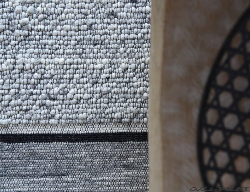 Wollen karpet zwart-wit