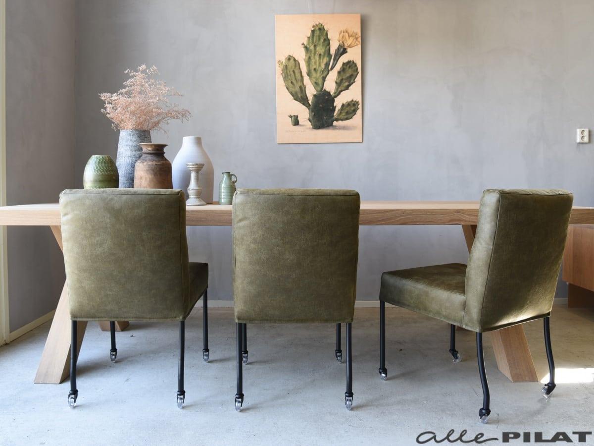 Groene eetkamerstoel bob op wielen in stof of leer woonwinkel